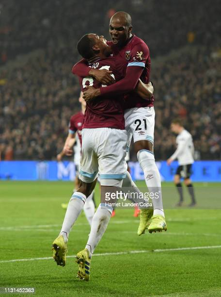 Issa Diop of West Ham United celebrates with teammate Angelo Ogbonna after scoring his team's second goal during the Premier League match between...