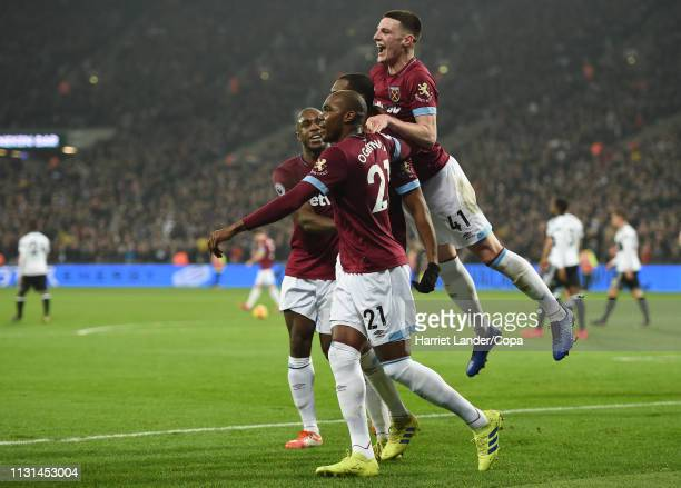 Issa Diop of West Ham United celebrates with teammates after scoring his team's second goal during the Premier League match between West Ham United...