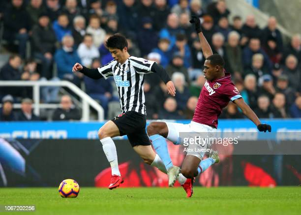 Issa Diop of West Ham United tackles Ki SungYueng of Newcastle United during the Premier League match between Newcastle United and West Ham United at...
