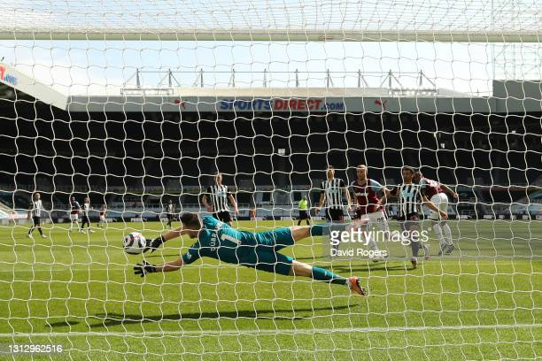 Issa Diop of West Ham United United scores their team's first goal past Martin Dubravka of Newcastle United during the Premier League match between...