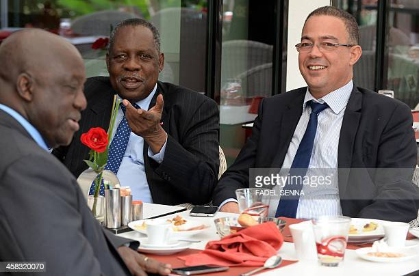 Issa Hayatou , CAF president, speaks to Fouzi Lekjaa , President of the Moroccan Football Federation , during breakfast on November 3, 2014 in Rabat,...