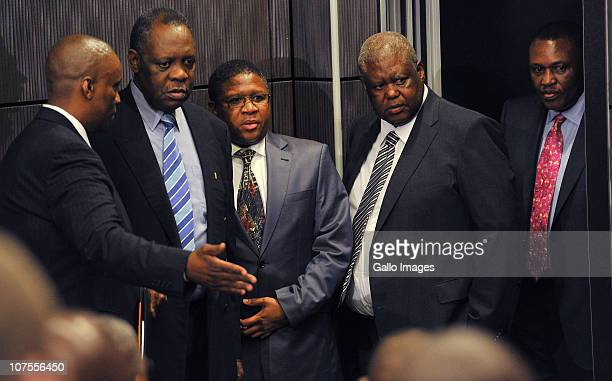 Issa Hayatou Minister of Sports Fikile Mbalula Molefe Olifant and Irvin Khoza arrive for the FIFA media briefing at Soccer City on December 13 2010...