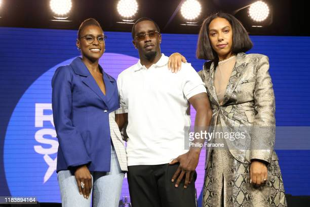 "Issa Rae, Sean ""Diddy"" Combs and Melina Matsoukas pose onstage at the REVOLT X AT&T Host REVOLT Summit In Los Angeles at Magic Box on October 27,..."