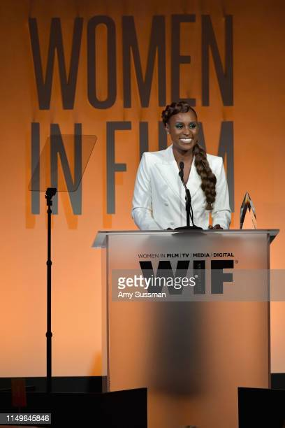 Issa Rae, wearing Max Mara, accepts the Women in Film Emerging Entrepreneur Award onstage at the 2019 Women In Film Annual Gala Presented by Max Mara...