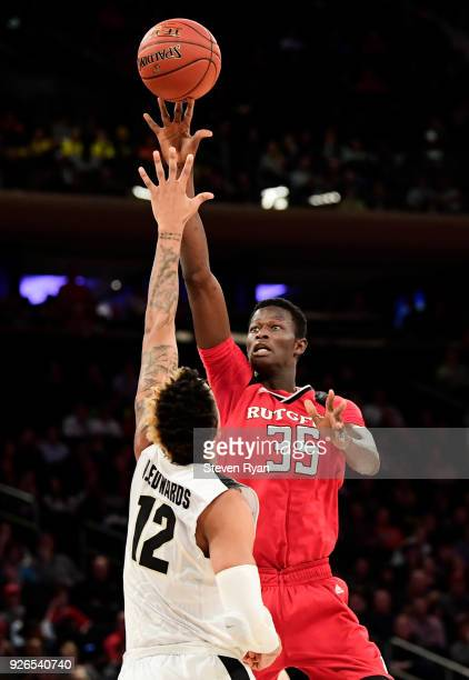 Issa Thiam of the Rutgers Scarlet Knights attempts a shot defended by Vincent Edwards of the Purdue Boilermakers during the quarterfinals of the Big...