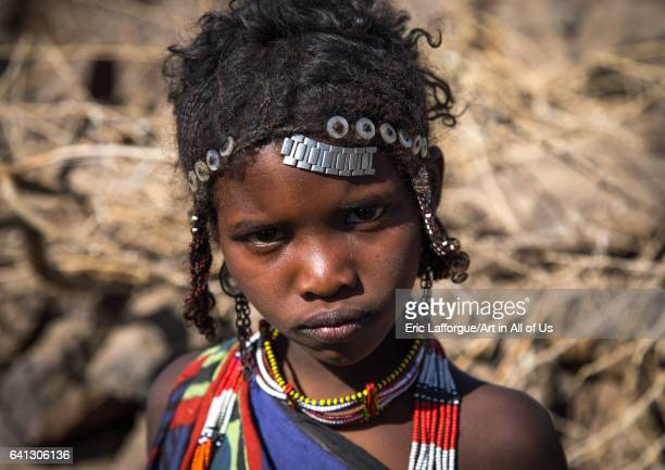 Issa tribe child girl with traditional hairstyle on January 14 2017 in Yangudi Rassa National Park Ethiopia