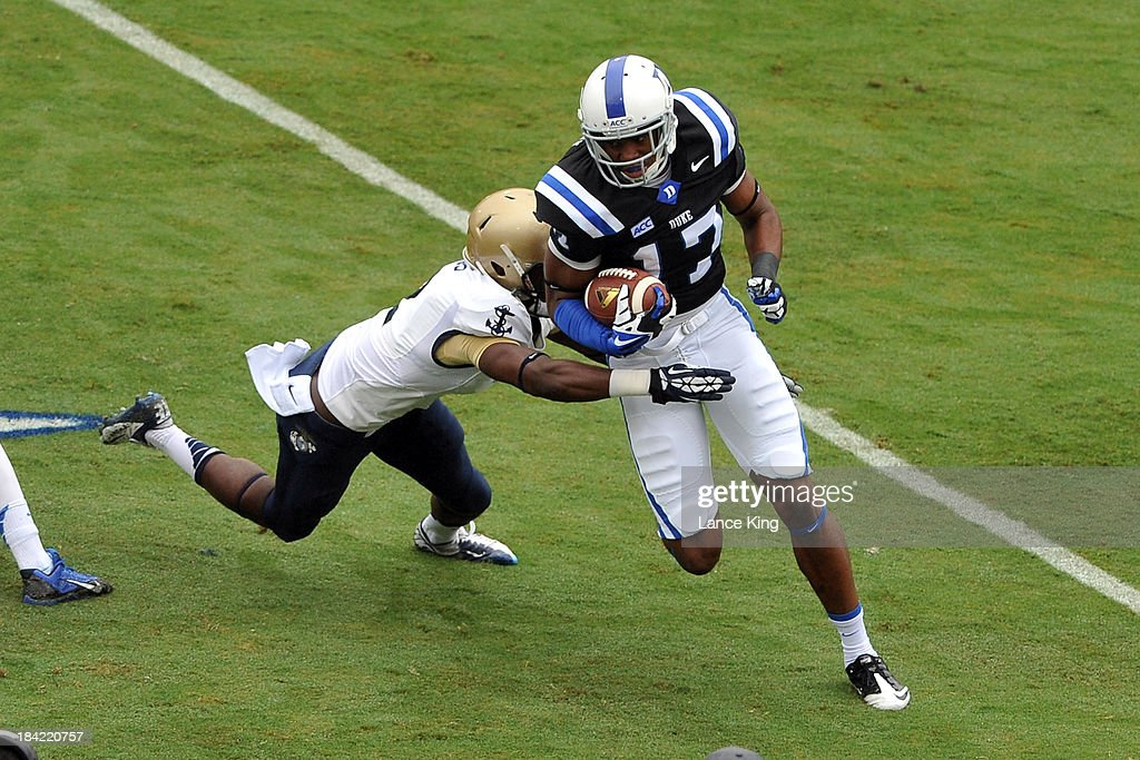 Issac Blakeney #17 of the Duke Blue Devils avoids a tackle by Parrish Gaines #2 of the Navy Midshipmen at Wallace Wade Stadium on October 12, 2013 in Durham, North Carolina.