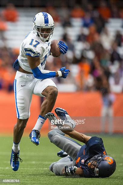 Issac Blakeney of the Duke Blue Devils runs past Julian Whigham of the Syracuse Orange after catching what would be a touchdown reception on November...