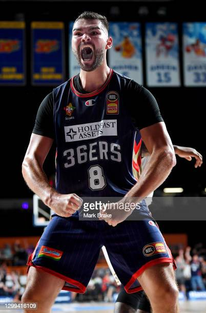 Issac Humphries of the 36ers celebrates a slam dunks during the round three NBL match between the Adelaide 36ers and the Sydney Kings at Adelaide...