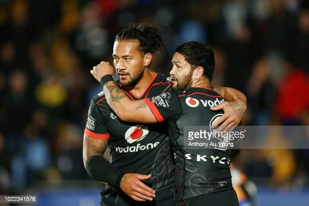 Issac Luke and James Gavet of the Warriors celebrate during the round 24 NRL match between the New Zealand Warriors and the Penrith Panthers at Mt...