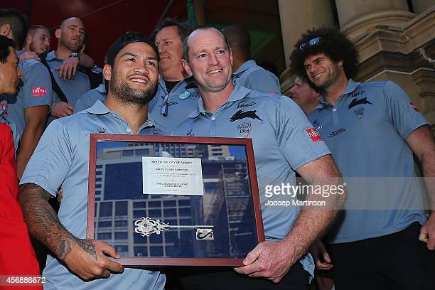 Issac Luke and Michael Maguire pose with the 'Key to the City' during a South Sydney Rabbitohs NRL Grand Final celebration at Sydney Town Hall on...