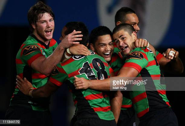 Issac Luke and other Rabbitohs players celebrate the try of Nathan Merritt during the round four NRL match between the South Sydney Rabbitohs and the...