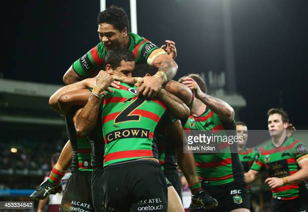 Issac Luke and other Rabbitohs team mates celebrate a try by Alex Johnston during the round 22 AFL match between the South Sydney Rabbitohs and the...