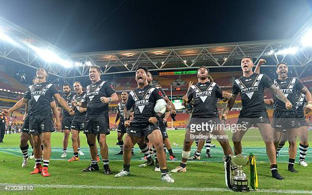Issac Luke of the Kiwis and team mates perform the Haka as they celebrate their victory after the TransTasman Test match between the Australia...