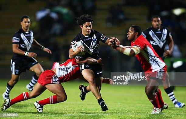 Issac Luke of the Kiwis is tackled by Eliakim Uasi of Tonga during the International Rugby League Federation Test match between the New Zealand Kiwis...