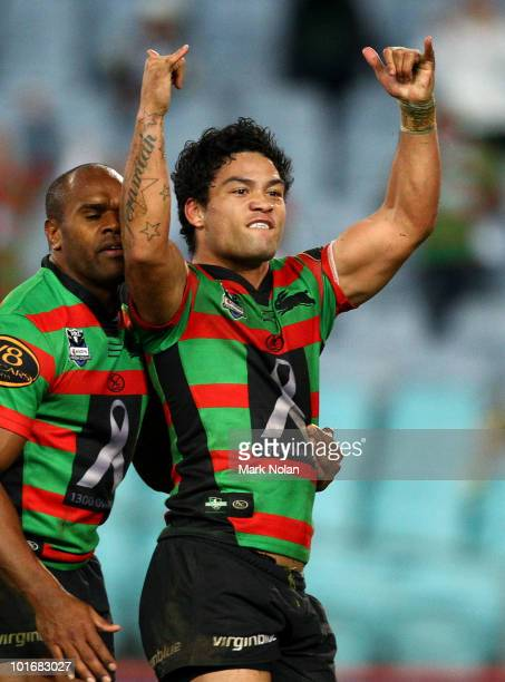 Issac Luke of the Rabbitohs celebrates scoring a try during the round 13 NRL match between the South Sydney Rabbitohs and the North Queensland...