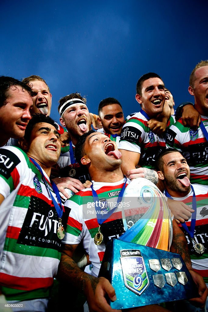 Issac Luke of the Rabbitohs celebrates with the trophy following during the grand final match between the South Sydney Rabbitohs and the Cronulla-Sutherland Sharks in the 2015 Auckland Nines at Eden Park on February 1, 2015 in Auckland, New Zealand.