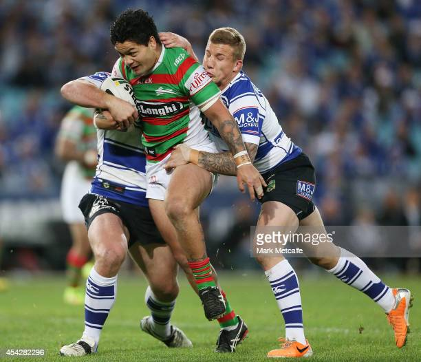 Issac Luke of the Rabbitohs is tackled by Trent Hodkinson of the Bulldogs during the round 25 NRL match between the Canterbury Bulldogs and the South...
