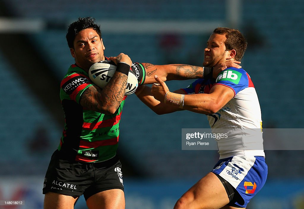 Issac Luke of the Rabbitohs is tackled by Tyrone Roberts of the Knights during the round 18 NRL match between the South Sydney Rabbitohs and the Newcastle Knights at ANZ Stadium on July 8, 2012 in Sydney, Australia.