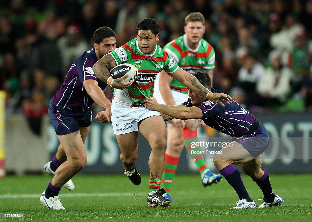 Issac Luke of the Rabbitohs is tackled during the round 22 NRL match between the Melbourne Storm and the South Sydney Rabbitohs at AAMI Park on August 9, 2013 in Melbourne, Australia.