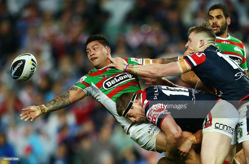 Issac Luke of the Rabbitohs offloads during the round 26 NRL match between the Sydney Roosters and the South Sydney Rabbitohs at Allianz Stadium on September 4, 2014 in Sydney, Australia.