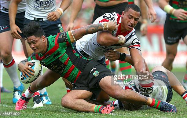 Issac Luke of the Rabbitohs scores a try in the tackle of Sio Siua Taukeiah of the Roosters during the round two NRL match between South Sydney...