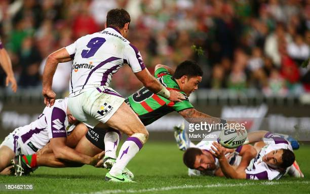 Issac Luke of the Rabbitohs stretches out to score during the NRL Qualifying match between the South Sydney Rabbitohs and the Melbourne Storm at ANZ...