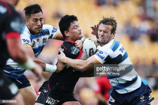 Issac Luke of the Warriors charges into Kane Elgey of the Titans during the round five NRL match between the New Zealand Warriors and the Gold Coast...