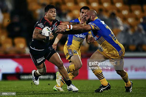 Issac Luke of the Warriors fends against Tim Mannah of the Eels during the round 26 NRL match between the New Zealand Warriors and the Parramatta...