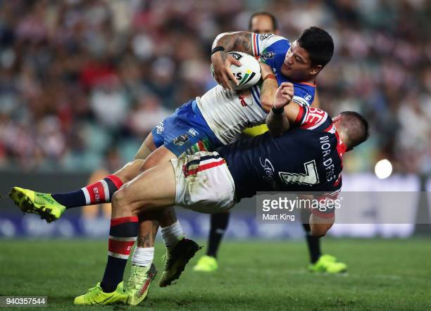 Issac Luke of the Warriors is tackled by Luke Keary of the Roosters during the round four NRL match between the Sydney Roosters and the New Zealand...