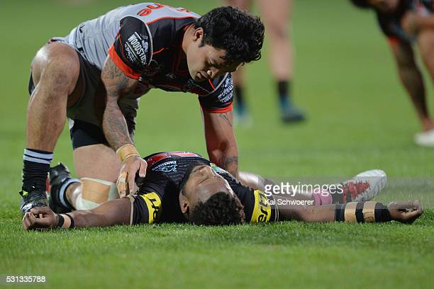 Issac Luke of the Warriors looks after James Segeyaro of the Panthers who lies on the field during the round 10 NRL match between the Penrith...