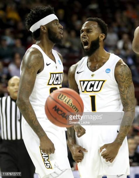 Issac Vann and Mike'L Simms of the Virginia Commonwealth Rams celebrate the basket against the UCF Knights in the second half during the first round...