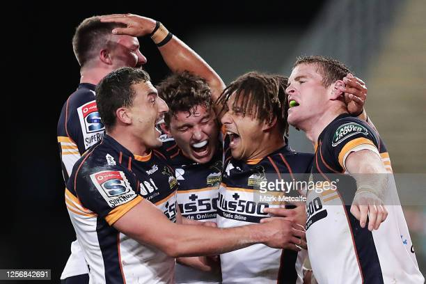 Issak Fines of the Brumbies celebrates scoring a try with team mates during the round three Super Rugby AU match between the Waratahs and the...