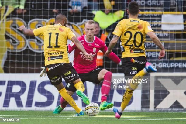 Issam Jebali of IF Elfsborg passes Simon Lundevall of IF Elfsborg who scores the opening goal 10 behind Pontus Dahlberg goalkeeper of IFK Goteborg...