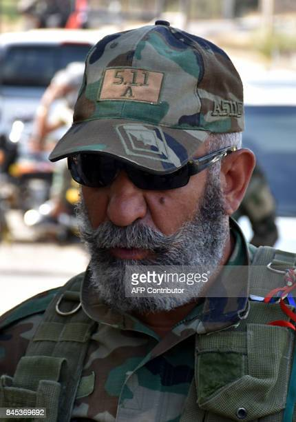 Issam Zahreddine Major General of the Syrian Republican Guard walks in the eastern city of Deir Ezzor on September 10 as they continue to press...