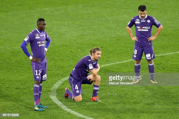 Issiaga Sylla and Yannick Cahuzac and Corentin Jean of Toulouse look dejected during the Ligue 1 match between Toulouse and OGC Nice at Stadium...