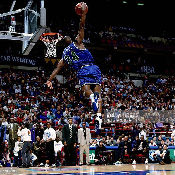 Issiah Rider of the Minnesota Timberwolves attempts a windmill jam during the 1994 Slam Dunk Contest February 12 1994 at the Target Center in...