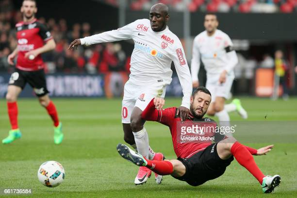 Issiar Dia of Nancy and Jonathan Martins Pereira of Guingamp during the French Ligue 1 match between Guingamp and Nancy at Stade du Roudourou on...