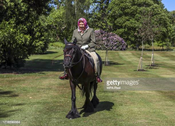 Issue date: Sunday May 31, Queen Elizabeth II rides Balmoral Fern, a 14-year-old Fell Pony, in Windsor Home Park over the weekend of May 30 and May...