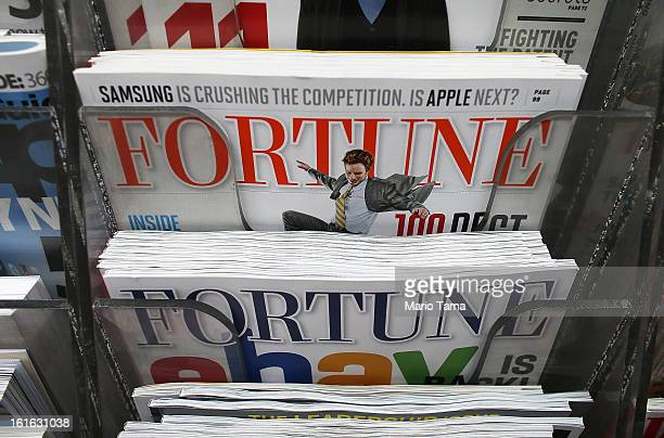 Issues of Fortune magazine are for sale at a newsstand in Manhattan on February 13 2013 in New York City Time Warner Inc is reportedly in talks to...