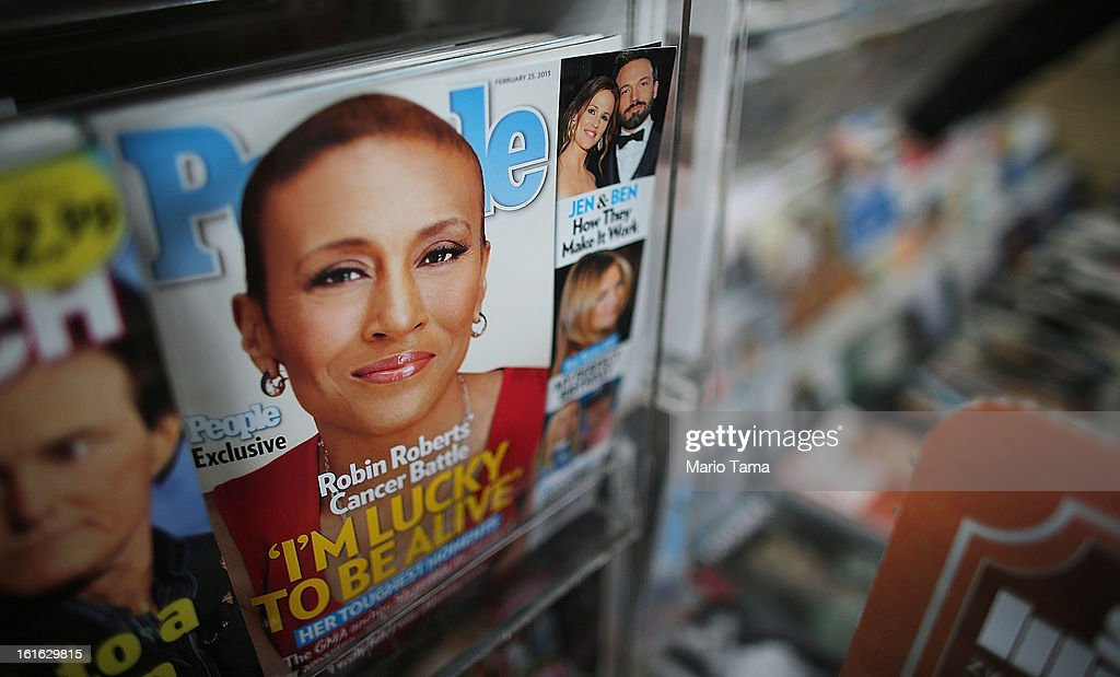 Issues of People magazine are for sale at a newsstand in Manhattan on February 13, 2013 in New York City. Time Warner Inc. is reportedly in talks to sell most of its magazine group, including People, InStyle and Entertainment Weekly, to the Meredith Corporation. Time Warner would reportedly retain control of flagship titles Time, Sports Illustrated and Fortune.