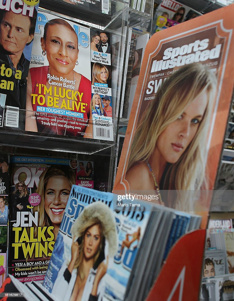 Issues of People magazine (TOP) are for sale next to Sports Illlustrated issues (R) at a newsstand in Manhattan on February 13, 2013 in New York City. Time Warner Inc. is reportedly in talks to sell most of its magazine group, including People, InStyle and Entertainment Weekly, to the Meredith Corporation. Time Warner would reportedly retain control of flagship titles Time, Sports Illustrated and Fortune.