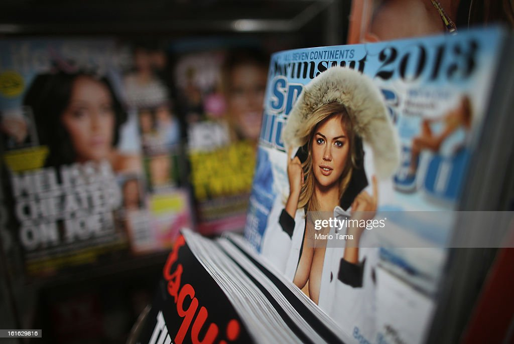 Issues of Sports Illustrated are for sale at a newsstand in Manhattan on February 13, 2013 in New York City. Time Warner Inc. is reportedly in talks to sell most of its magazine group, including People, InStyle and Entertainment Weekly, to the Meredith Corporation. Time Warner would reportedly retain control of flagship titles Time, Sports Illustrated and Fortune.