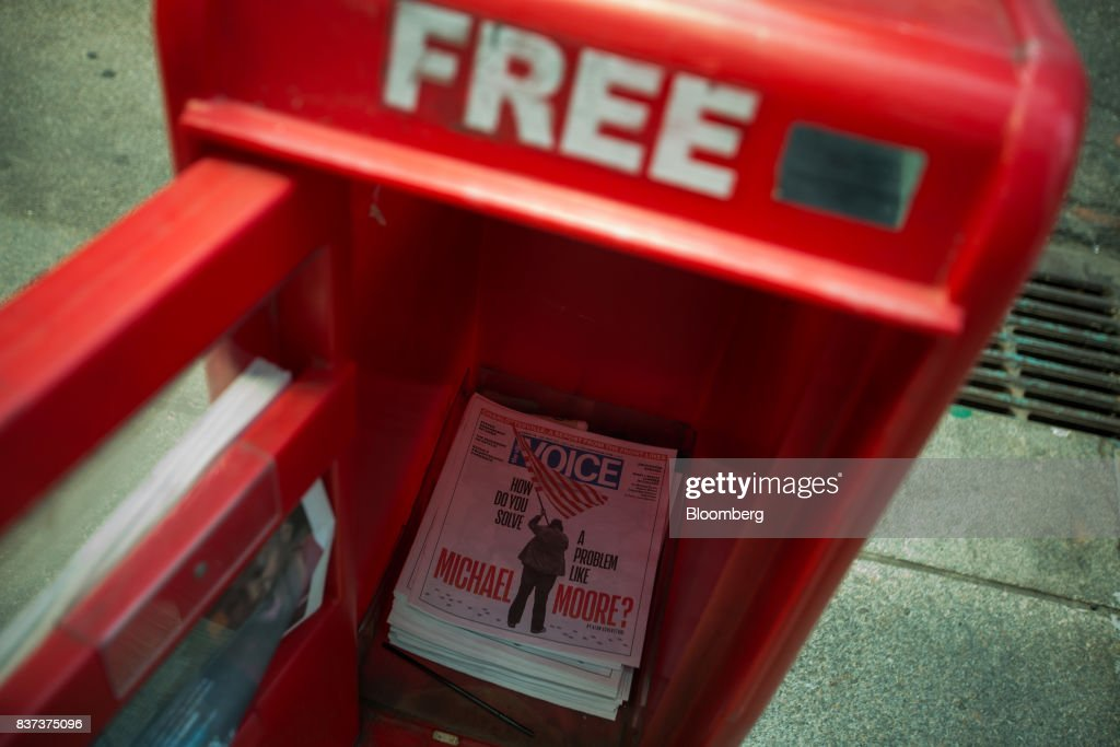 Issues of The Village Voice is seen inside a distribution box in the East Village neighborhood of New York, U.S., on Tuesday, Aug. 22, 2017. Peter Barbey, owner of The Village Voice since 2015, has decided to no longer produce a print edition of the alt-weekly publication. The company's announcement, made Tuesday afternoon, came as a surprise, a shock and a disappointment to the larger media industry on Twitter. Photographer: Michael Nagle/Bloomberg via Getty Images