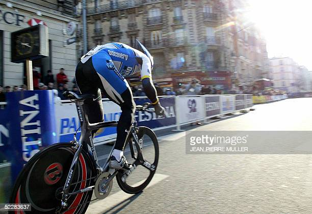 US Discovery Channel cycling team leader Lance Armstrong of the United States leaps forward 06 March 2005 in Issy les Moulineaux outside Paris before...
