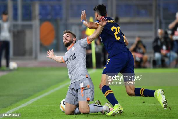 Istanbul Basaksehir FK's Bosnian midfielder Edin Visca and AS Roma's Argentinian midfielder Javier Pastore go for the ball during the UEFA Europa...