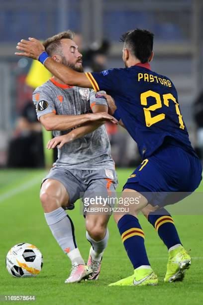 Istanbul Basaksehir FK's Bosnian midfielder Edin Visca and AS Roma's Argentinian midfielder Javier Pastore collide during the UEFA Europa League...