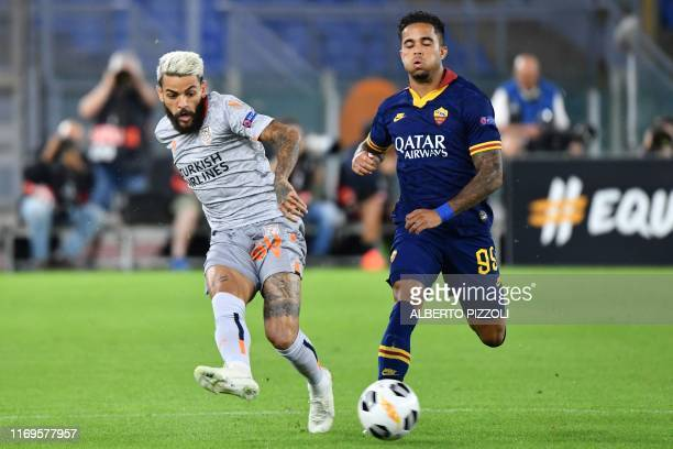 Istanbul Basaksehir FK's Brazilian defender Junior Caicara passes the ball despite AS Roma's Dutch forward Justin Kluivert during the UEFA Europa...