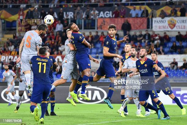 Istanbul Basaksehir FK's Turkish midfielder Mehmet Topal goes for a header during the UEFA Europa League Group J football match AS Roma vs Istanbul...