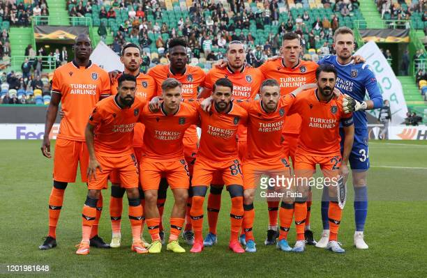 Istanbul Basaksehir players pose for a team photo before the start of the UEFA Europa League Round of 32 - First Leg match between Sporting CP and...
